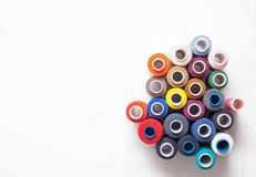 Colored thread coils on white background, sewing tools. Colored thread coils on white background, sewing, place for text Stock Photos