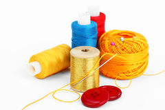 Colored thread, needles Royalty Free Stock Photos