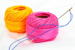 Colored thread, needles Stock Photos