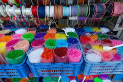 Colored thread, ribbons,beads Stock Photos