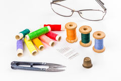Colored thread with scissors on white background. The Colored thread with scissors on white background Royalty Free Stock Photos