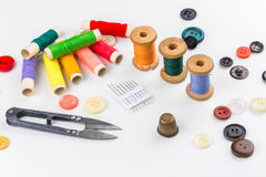 Colored thread with scissors on white background Stock Photos