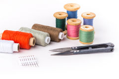 Colored thread with scissors on white background. The Colored thread with scissors on white background Stock Photos