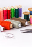 Colored thread with scissors on white background. The Colored thread with scissors on white background Royalty Free Stock Photography