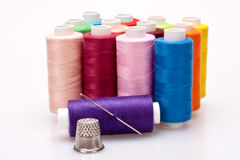Colored thread for sewing with needle and thimble Royalty Free Stock Photos
