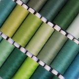 Colored thread for sewing.Threads in spools Stock Photo