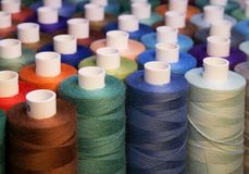Colored thread for sewing. Threads in spools Royalty Free Stock Images