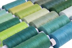 Colored thread for sewing.Threads in spools Stock Photos