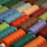 Colored thread for sewing. Threads in spools Royalty Free Stock Photography