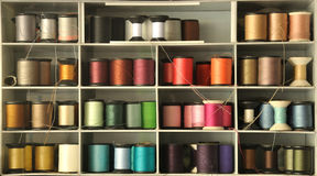 Colored thread on shelf Royalty Free Stock Images