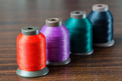 Colored thread. On the table Stock Photos