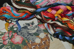 Colored thread and unfinished embroidery stock images