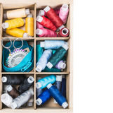 Colored thread in a wooden in box Royalty Free Stock Photos