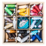 Colored thread in a wooden in box Stock Photos