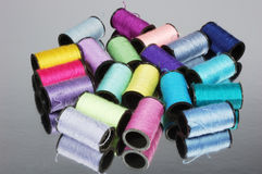 Colored threads. Stack of different colors threads , close up Royalty Free Stock Image