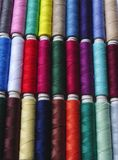Colored threads. Closeup of various colored spools of thread Royalty Free Stock Image
