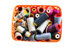 Colored threads in a basket Stock Images