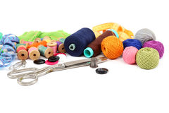 Colored threads, buttons, fabric and scissors. Royalty Free Stock Images