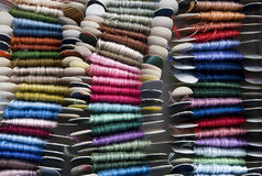 Colored threads for cross stitch. Many colorful skeins of yarn for cross stitch Stock Photos