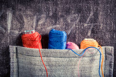 Colored threads in the pocket of the mat tailor Royalty Free Stock Images