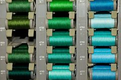 Colored threads on the coils stock photos