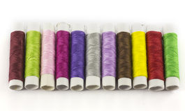 Colored threads for sewing and needle Stock Photo