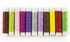 Colored threads for sewing and needle Royalty Free Stock Photo