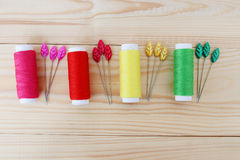Colored threads on wooden background. Sewing kit. Set for needlework Royalty Free Stock Photography
