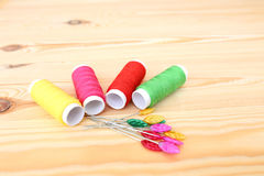 Colored threads on wooden background. Sewing kit. Set for needlework Royalty Free Stock Photos