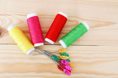Colored threads on wooden background. Sewing kit. Set for needlework Royalty Free Stock Images