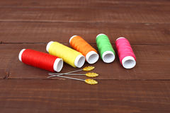 Colored threads on wooden background. Sewing kit. Set for needlework Stock Images