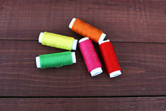 Colored threads on wooden background. Sewing kit. Set for needlework Royalty Free Stock Image