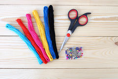 Colored threads on wooden background. Sewing kit. Set for needlework Royalty Free Stock Photo