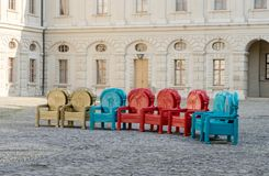 Colored throne chairs. In front of the Weimar City Palace stock photo