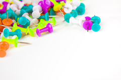Colored thumbtacks on a white background Royalty Free Stock Image