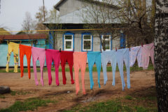 Colored tights. Colorful children's stockings hanging on a rope Stock Image