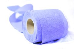 Colored toilet paper blue indigo. Enjoy the rainbow soft and clean Stock Images