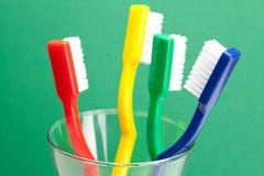 Colored toothbrush in a glass Royalty Free Stock Photography