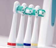 Colored Toothbrushes. Four colored toothbrushes lined up in a row stock image