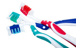 Colored toothbrushes. Fashion colored toothbrushes on a white background Stock Photos