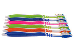 Colored toothbrushes. White background. (Clipping path) Royalty Free Stock Photography