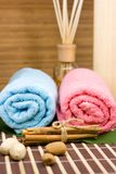 Colored towels. Towels on green palm leaf and bamboo background Royalty Free Stock Photography