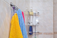 Colored towels on the rack Stock Image