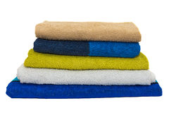 Colored towels stacked isolated on white background Royalty Free Stock Photography