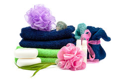Colored towels, washcloths, shampoo and soap Stock Images