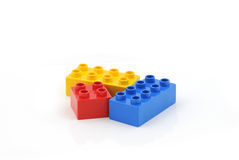 Colored toy blocks. Isolated on white background stock photography