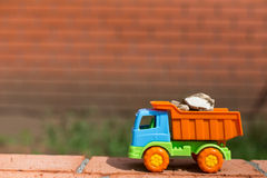 Colored toy truck with sand and stones Stock Photography