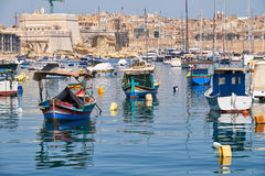 Colored traditional fishing boats Luzzu in Marsaxlokk harbor,. Colored traditional maltese boats Luzzu moored in the of Marsaxlokk bay, Malta Stock Images