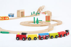 Colored train with cars and wooden toy railway. On white background. Focus on train royalty free illustration
