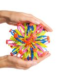 Colored transformer ball in hand isolated on white background.  Royalty Free Stock Photo